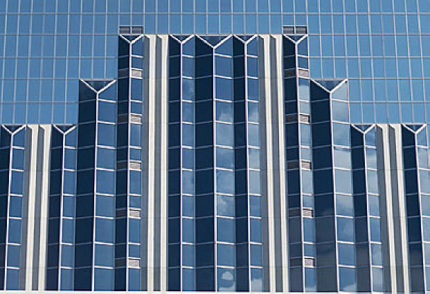 front-of-blue-glass-building-uid-1177327